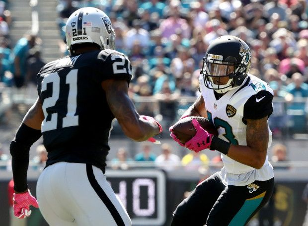 Raiders vs. Jaguars:     October 23, 2016  -  33-16, Raiders  -   Rashad Greene #13 of the Jacksonville Jaguars looks to elude Sean Smith #21 of the Oakland Raiders during the game at EverBank Field on October 23, 2016 in Jacksonville, Florida.  (Photo by Sam Greenwood/Getty Images)