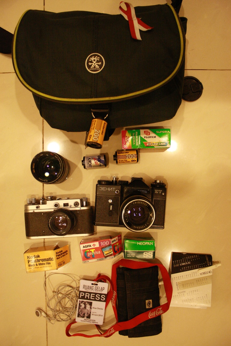 Updating my photography bag. Zenit ET | Haiou-64 58mm f/2 | Jupiter 37AM 135mm f/3.5 | Zorki S | Jupiter-8 50mm f/2 | Color, BW, and Slide films | Earphone, wallet, ID Card, Notebook, pen