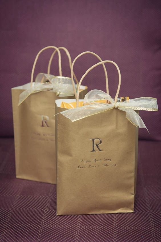 One of our favorite parts of hosting a hotel wedding is putting together welcome bags for your guests staying at the hotel. We like filling ours with an event agenda, a map of the area, party favors and custom door hangers.