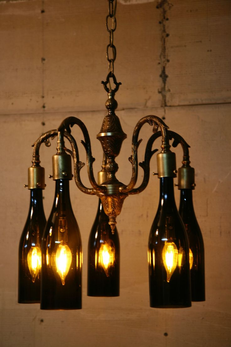 I Found an old chandelier in the trash and gave it new life as a Wine Bottle Chandelier.