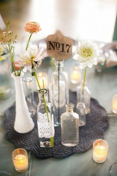 centerpiece idea: glass bottles, doilies, knit placemat.