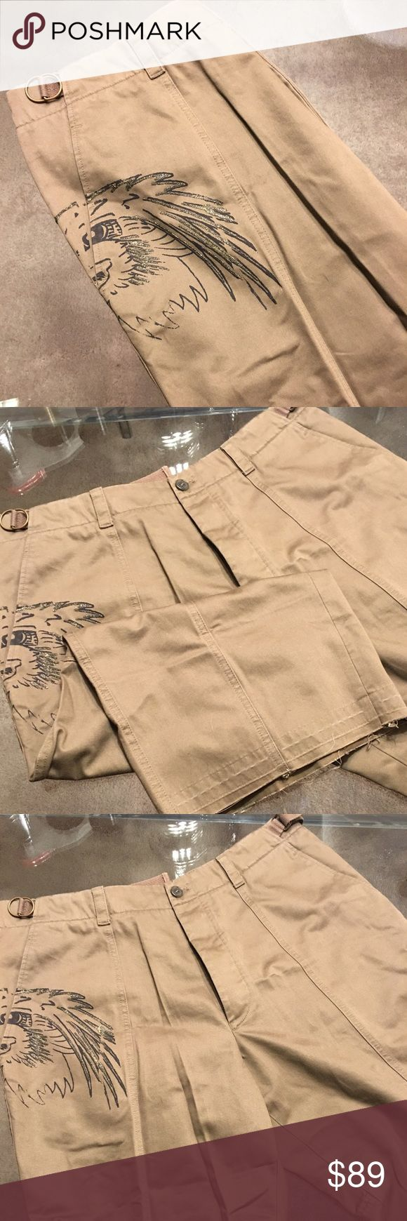 🌟HUGO BOSS MENS SHORTS 💯 AUTHENTIC HUGO BOSS MENS LONG SHORTS 💯AUTHENTIC. OLIVE GREEN EAGLE PRINTED SHORTS. VERY HIGH END DESIGNER FASHION LOOK. THEY FALL ROUGHLY CALF LENTH. THEY ARE SIZE TAGGED AT A 38 Hugo Boss Shorts Hybrids