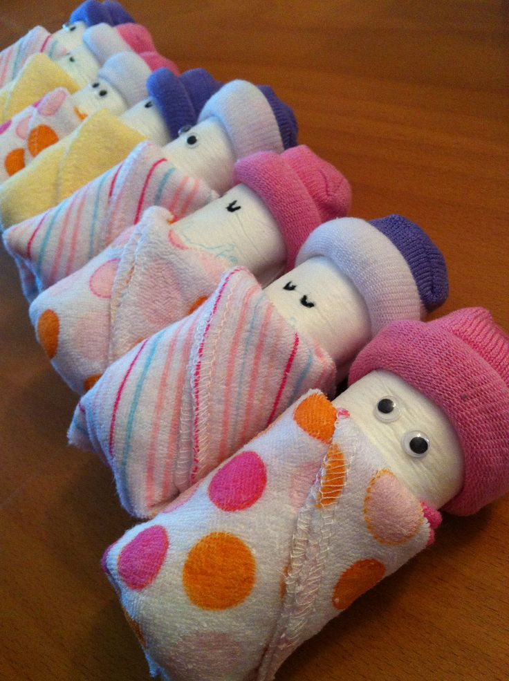Diaper Babies :) newborn diapers + rolled up baby socks + washcloth = great shower gift!