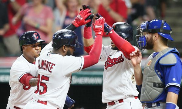 Cleveland Indians Jose Ramirez and Carlos Santana celebrate with Abraham Almonte after Almonte hit a 3 run homer to put the Indians up 11-3 over the Toronto Blue Jay , 7th inning, at Progressive Field, on July 21. 2017. (Chuck Crow/The Plain Dealer). Indians won 13-4