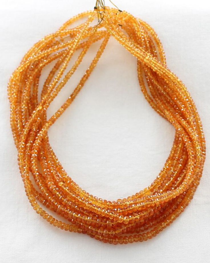 AAA MANDARIN GARNET FACETED RONDELLE BEADS 3.5-5mm from New World Gems