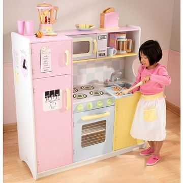 KidKraft Wooden Kitchen and Refrigerator provides all the fun and fantasy for open-ended imaginative play in the heart of the home. Thoughtful and creative details abound. The pink refrigerator and freezer are frescoed with a water and ice dispenser, a clock, a phone and a notepad. Also with doors that open and close for pretend food and utensils to be stored. Even the microwave and oven have clear see thru doors to make sure the meal is prepared to pefection!