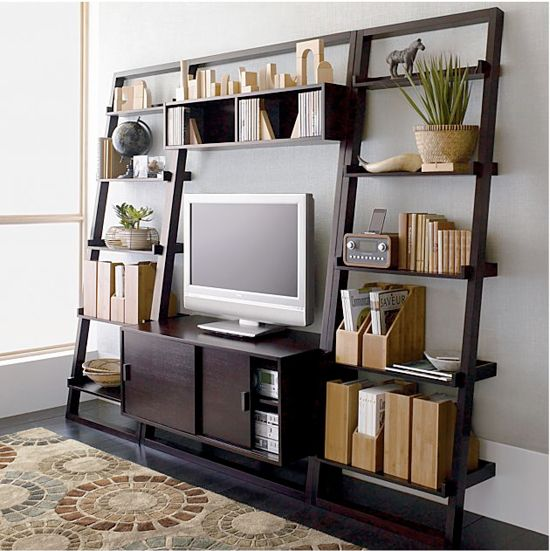 A leaning wall unit with ample room for books and display items makes a simple and spacious media storage solution.