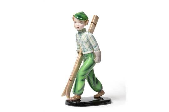 An Art Deco Goldscheider Figure, designed by Stefan Dakon, circa 1937, model 7562, a boy skier we