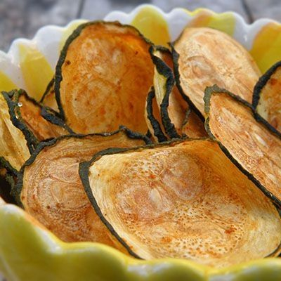 Baked Zucchini Chips 225 degrees spray baking sheet with canola oil cooking spray.  Slice zucchini into thin medallions, about the thickness of a quarter.  Place on cooking sheet spray with canola oil Sprinkle lightly with seasoning salt. Bake 45 minutes.  Rotate baking sheet bake  30-50 minutes more, until chips are browned and crisped to your liking. by diane.orcutt.1