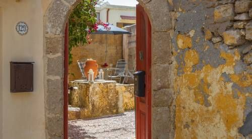 The Old Town House Rhodes Town The Old Town House is a holiday home with a terrace, set in Rhodes Town, 600 metres from Clock Tower. Guests benefit from patio. Free WiFi is provided throughout the property.  An oven, a fridge and a stovetop can be found in the kitchenette.
