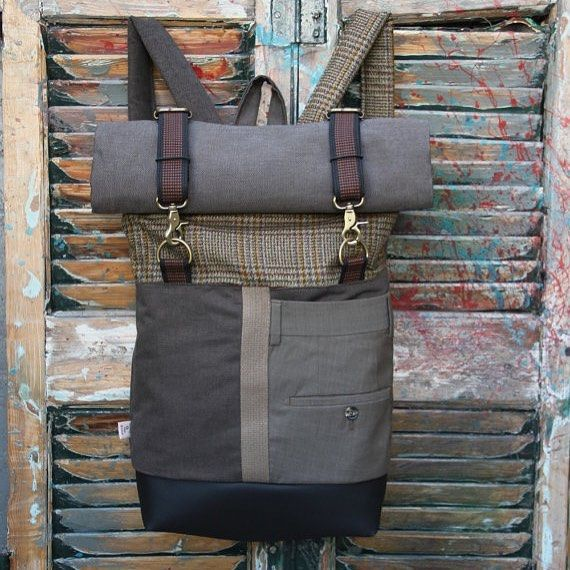 Brown roll top rucksack with two metal hooks for securing & the back part of a men's suit trousers serving as a double pocket #eatingthegoober #backpack #rolltop #upcycle #recycledmenswear