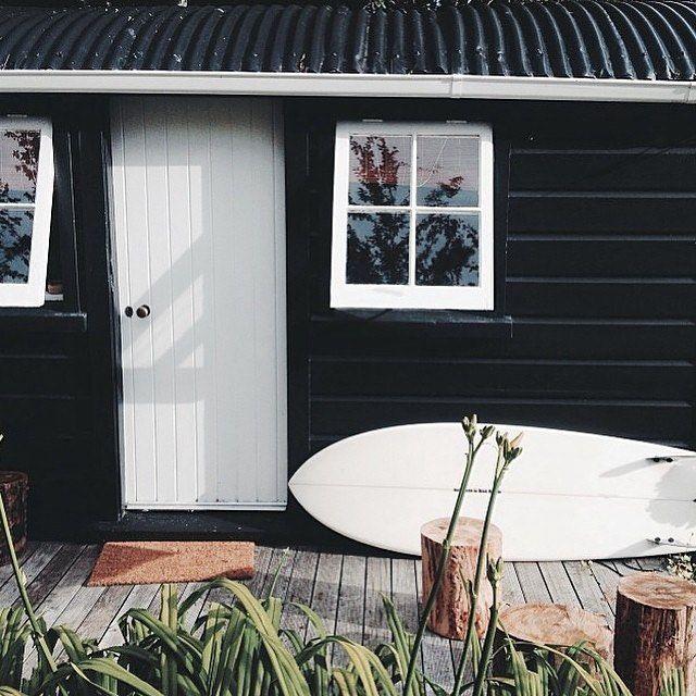 The dramatic black facade transforms this beach shack.