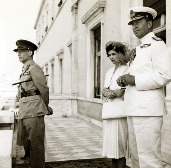 King George of Greece (in khaki, with staff) went into exile when the Axis powers occupied Greece in 1941. His return to Greece, forced by British arms, helped to ignite a communist insurgency that lasted from 1946 to 1949 and devastated an already half dead country. With him are his brother, Prince (later King) Paul and his wife Princess (later Queen) Frederica.