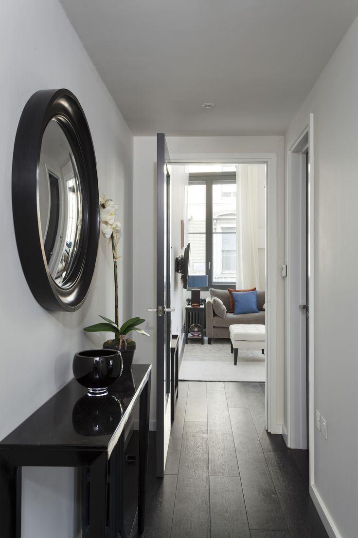 Large Waxed Black Convex Mirror, Hanging In This Lovely Hallway Interior  Scheme By Gordon
