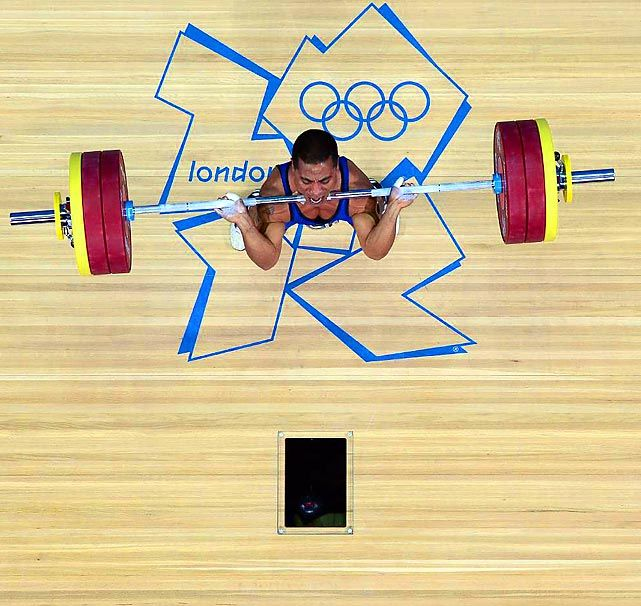 Micronesia's Manuel Minginfel begins to hoist the bar above his head in the men's 62kg  #london2012