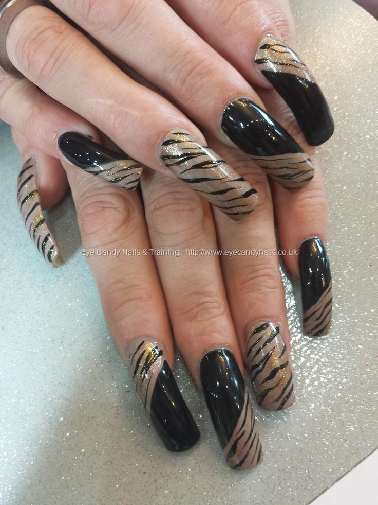 Black and nude freehand nail art