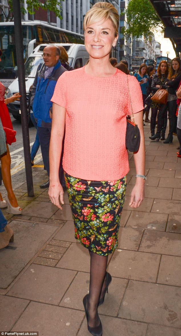 http://news-all-the-time.com/2014/05/14/tamzin-outhwaite-makes-fashion-faux-pas-in-a-frumpy-coral-top-and-black-sheer-tights-as-she-enjoys-a-night-out-at-the-theatre/ - Tamzin Outhwaite makes fashion faux pas in a frumpy coral top and black sheer tights as she enjoys a night out at the theatre  - By Danielle Gusmaroli  She was enjoying a well-earned girls' night out on the town.  But Tamzin Outhwaite suffered something of a fashion faux pas as she spent a night at the t