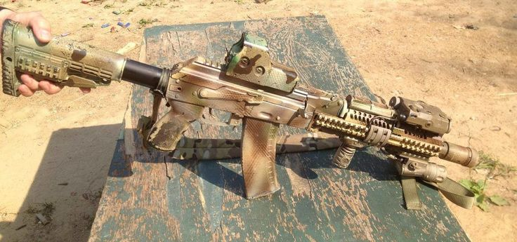 SOF AK-105 (Anyone know if this integrally suppressed?)