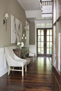 Benjamin Moore Berkshire Beige AC-2 / Flat.  Gorgeous!  Also love the entry way table.