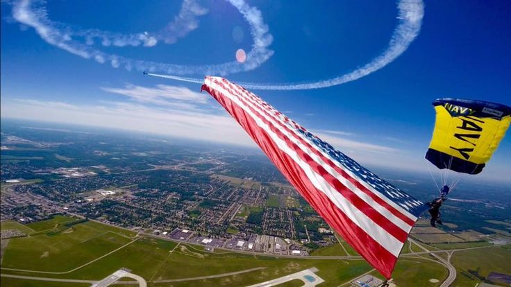 DAYTON, Ohio (June 19, 2016) Members of the U.S. Navy Parachute Team, the Leap Frogs, perform a tethered flag with the Star-Spangled Banner during a skydiving demonstration at the Dayton Air Show. The Navy Parachute Team is based in San Diego and performs aerial parachute demonstrations around the nation in support of Naval Special Warfare and Navy recruiting. (U.S. Navy photo by Jim Woods/Released)