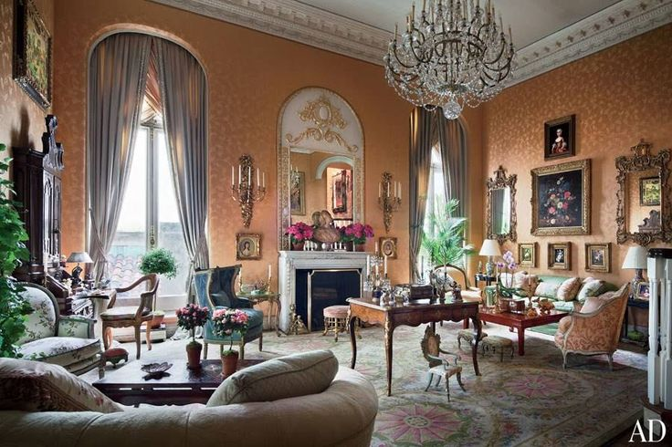 The society columnist known as Suzy called on Buatta, a longtime friend, to decorate her Manhattan apartment in a 1903 townhouse designed by architect Horace Trumbauer. An apricot silk covers the walls of the grand living room, shown, which was previously a ballroom. (January 2012)