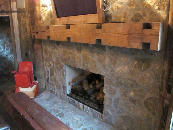 Stone Fireplace with reclaimed wood mantel complete with mortise and tenons