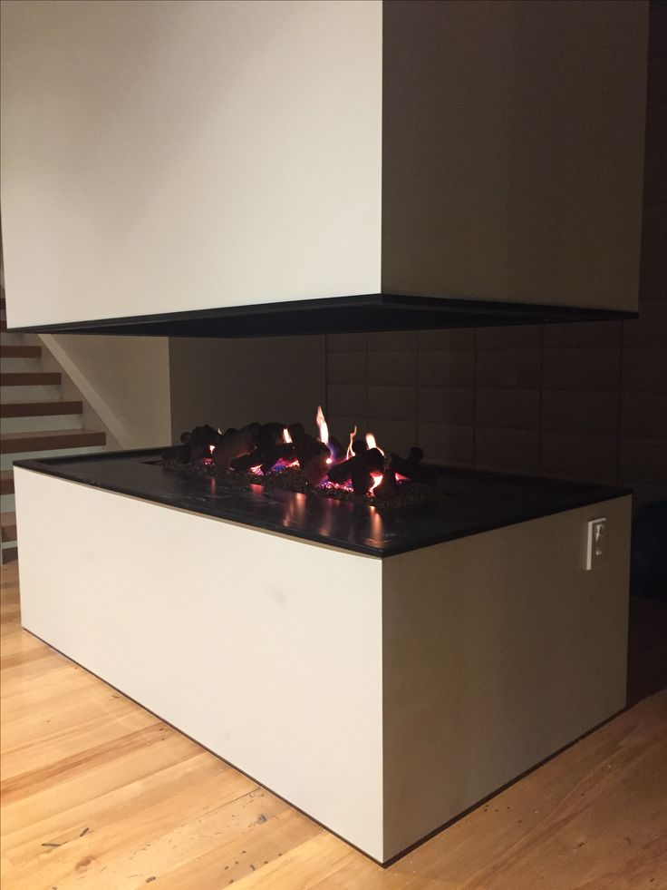 Waverley house, Dunedin NZ. Custom floating fireplace.  New build by Copland Building. Recycled rimu flooring.