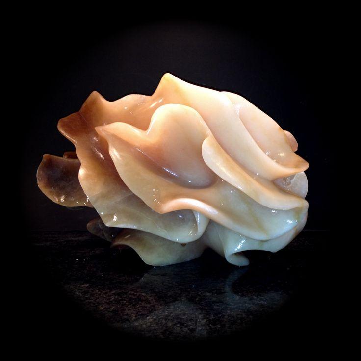 Coral Art (work in Progress) - Brown Alabaster - Sculpture made by Agnes Verweij, Netherlands (2014).    De sculptuur is nog lang niet af.  Ik wil met kleine veranderingen in het ritme van de vormgeving de sculptuur spannender maken. Daarna volgt de afwerking: het schuren en polijsten zal vele uren in beslag nemen. Nu al lijkt het albast licht te vangen en het weer uit te stralen. En als het licht verandert, verandert het hele beeld! Wordt vervolgd!