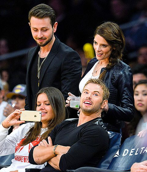 Twilight Saga brethren Ashley Greene (standing, with boyfriend Paul Khoury) and Kellan Lutz (seated, with unidentified pal) caught up inside the Staples Center as the Lakers faced off with the Sacramento Kings April 15.