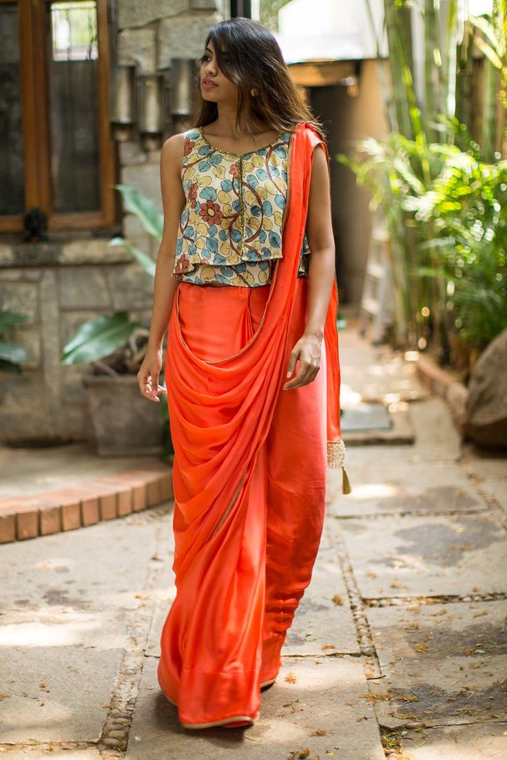 Peppy uplifting fresh rejuvenating Orange…in the form of a soft satin georgette drape with subtle gold edge detailing. Don this happy feminine drape and be the prettiest one of them all!Any complementing floral blouse or crop top will do nicely for this lovely number. Or pair with a plain orange or blue or even a black blouse with sparkle border detailing for a plain on plain look. #kalamkari #saree #india #blouse #houseofblouse