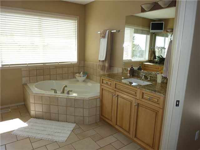 This 5 piece master ensuite comes equipped with a large jetted tub  www.heatherdavis.ca