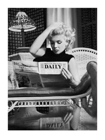 Marilyn Monroe Reading Motion Picture Daily, New York, c.1955 -- Print by Ed Feingersh at Art.com