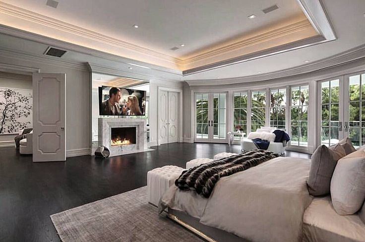 Master suite with doors separating sitting area/closet, double sided fire place