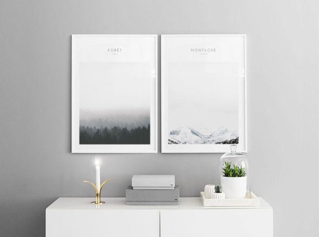 Tavelvägg. Snyggt par med posters i storleken 50x70cm. Fina i vita ramar. Fotografier med naturbilder av skog och berg. Desenio.com