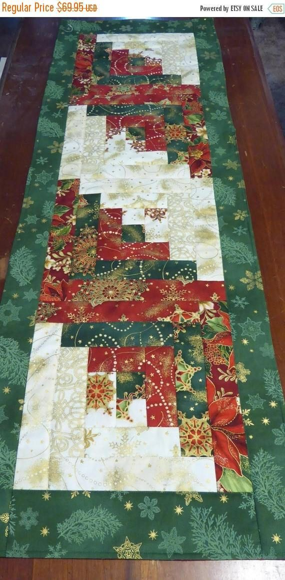 This Quilted Table Runner is a Beautiful Christmas One as you can see from the beautiful fabrics used in it. It is reversible. One side in the Log Cabin Design and the other side is adorned with Gorgeous Poinsettias . It measures 14 X 44. My Quilted Table Runners will add color