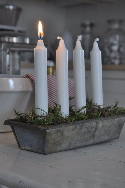 Advent candles - I wonder if I could find a cool old cake tin that is round? I love this idea but still want the round wreath.