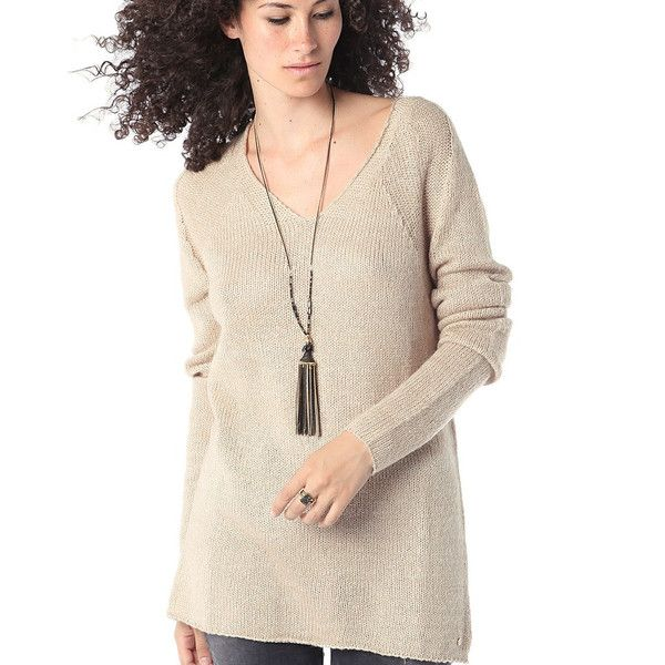 Q2: We're a women's fashion brand with a high-street mind but a Haute Couture heart located in Spain. Long beige sweater with long sleeves and V-neckline. Black
