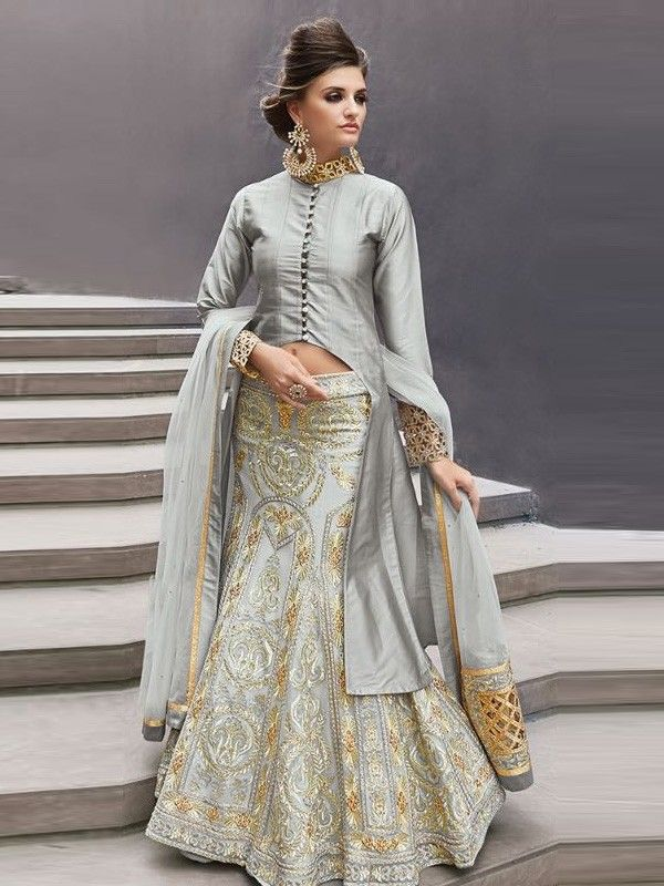 This graceful celeb style Peach Colour designer lehenga choli with intricate golden embroidery makes it a unique and elegant party wear, bridal dress, mehndi or wedding reception dress. Create your own looks and express your style as you can wear the lehenga (skirt) with a choli (blouse) or a full sleeved, knee length kameez (jacket). A matching dupatta (scarf) comes along to complete your perfect look.  NOTE: Kameez (jacket) length can be made so as to cover the belly if required. Also…