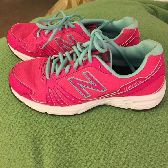 Neon running shoes! Super girly! Practically new! Very girly to hit the gym or running trails in! I only wore them once and only selling because I have several pairs of running shoes and these are not getting worn. These are very bright and add a nice pop of color to any outfit! New Balance Shoes Sneakers