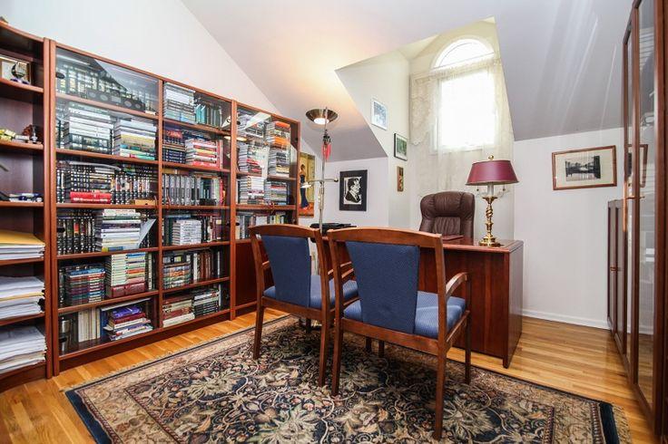 Traditional Home Office with Built-in bookshelf, Carpet, Hardwood floors, High ceiling, flush light