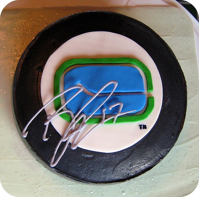 and who wouldn't love their birthday cake autographed in icing by a real life NHL player?! What up Ryan Kesler! Way to sign a cake! :-)
