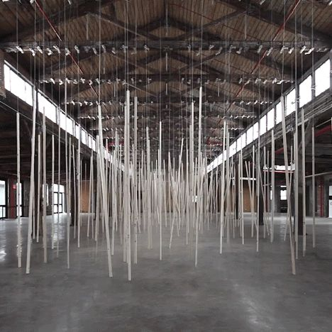 Vertical wooden laths cyclically pummel the floor of a cavernous New York factory building in this installation by Swiss artist Zimoun.