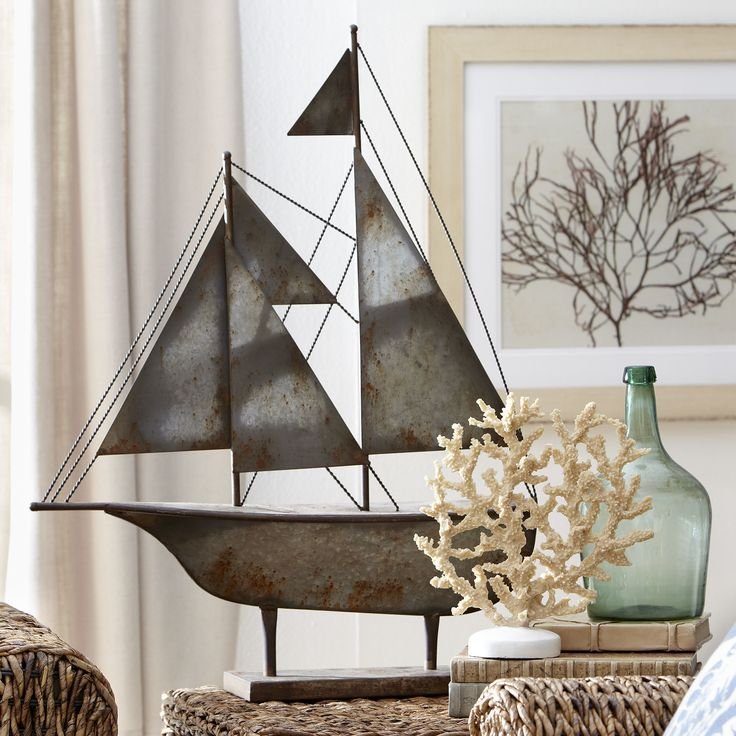 Metal Sailboat Decor | This detailed sailboat decor brings maritime charm to any room.