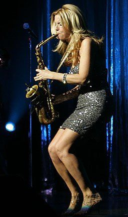Candy Dulfer ~ Dutch smooth jazz alto saxophonist who began playing at the age of six. She founded her band, Funky Stuff.