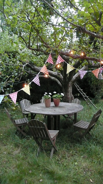 Weathered wooden furniture, vintage fabric flags for intimate outdoor fun