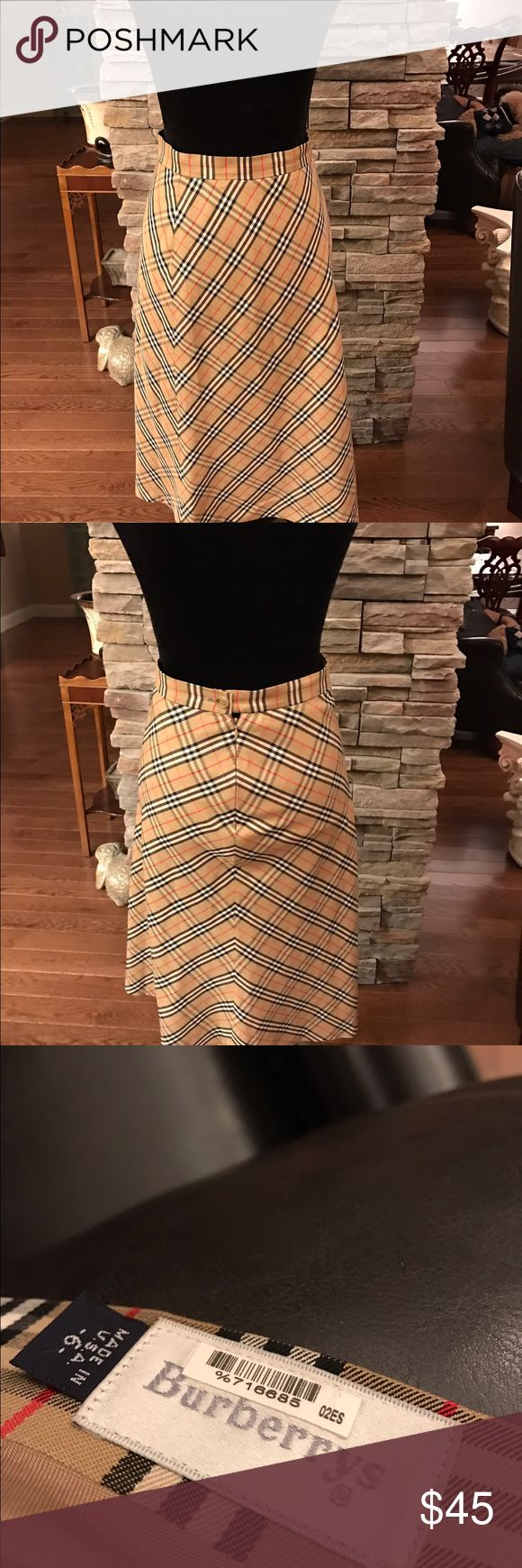 Burberry skirt Burberry skirt, maybe worn once.  It is 28 inches long, and waist is 27 1/2 inches, button closed, pja0 Burberry Skirts Midi