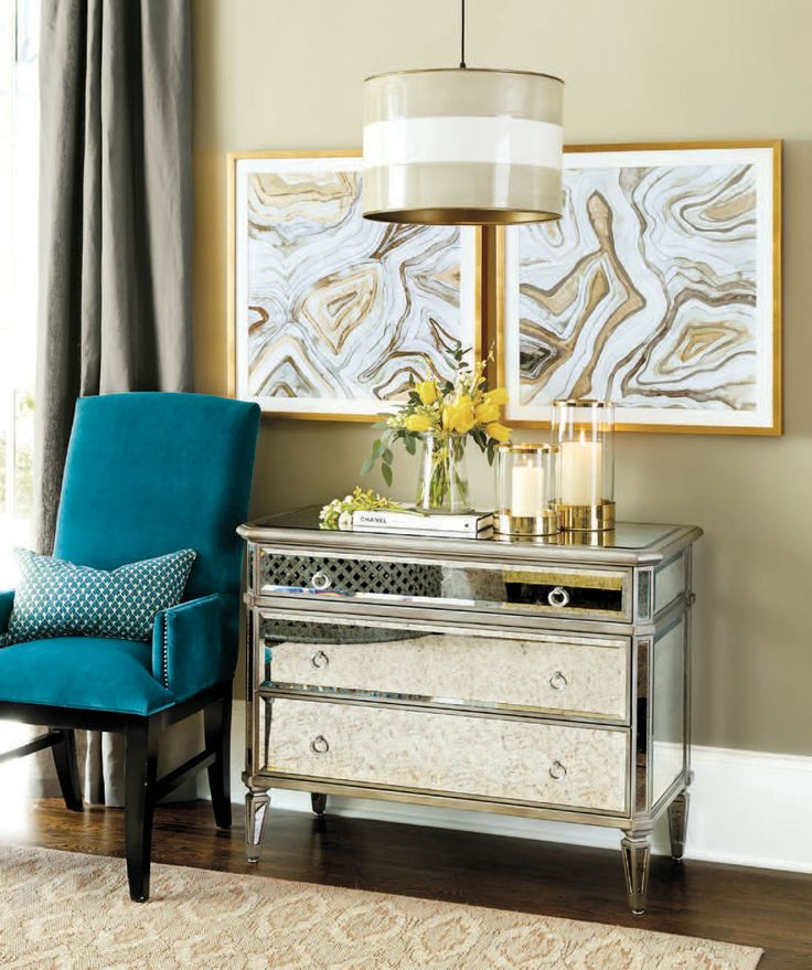 We love mirrored dressers in an entryway because they bounce light around the space, and entries are often small and cramped. A perfect solution!