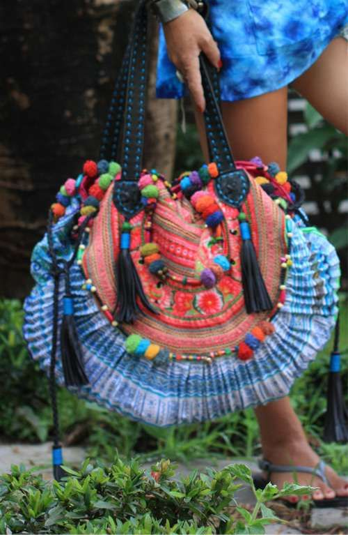 A genuine soft black leather shoulder bag handmade in Thailand with hand woven HMONG Hill Tribes fabric