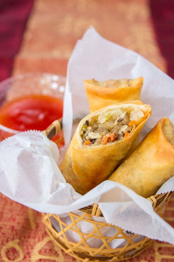 These spring rolls have savory pork, cabbage, glass noodles, carrots and mushrooms wrapped in a thin crackly crisp shell.