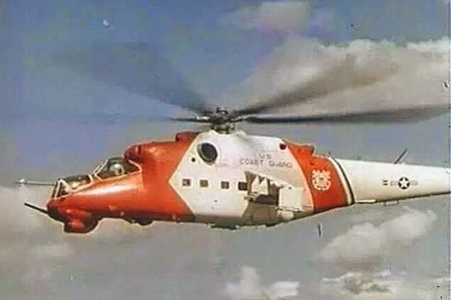 """Why Is This Mi-24 Hind Wearing U.S. Coast Guard Colors? Apparently, these are screencaps from some '80s Russian action movie, one in which the US Coast Guard was a way more aggressive fighting force than their actual mission requires. Still, the Hind looks quite dapper in its Coastie clothes don't you think?"" - http://foxtrotalpha.jalopnik.com/why-is-this-mi-24-hind-wearing-u-s-coast-guard-colors-1644434863/+matthardigree"